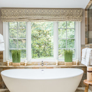 This is an example of a mediterranean bathroom in Richmond with a freestanding tub.