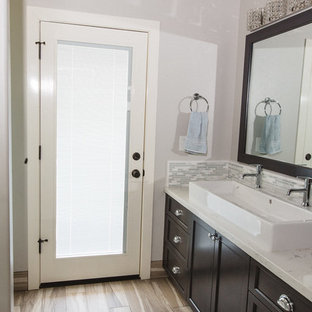 This is an example of a large transitional master bathroom in Boston with recessed-panel cabinets, dark wood cabinets, gray tile, white tile, matchstick tile, white walls, plywood floors, a trough sink, quartzite benchtops and an alcove shower.