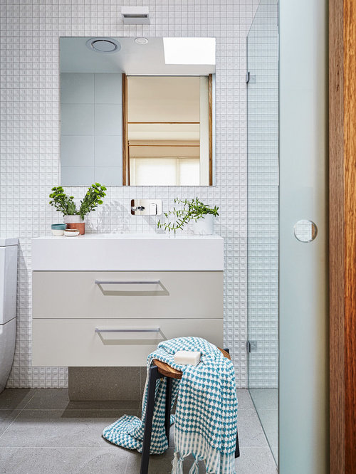 This Is An Example Of A Small Contemporary 3/4 Bathroom In Melbourne With  Beige