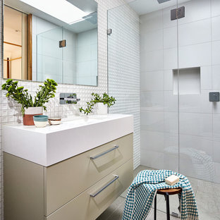 Design ideas for a small contemporary bathroom in Melbourne with beige cabinets, porcelain tile, white walls and solid surface benchtops.