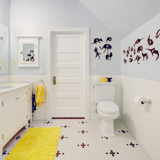 Example of a mid-sized transitional kids' subway tile and white tile mosaic tile floor and white floor bathroom design in San Francisco with recessed-panel cabinets, white cabinets, a two-piece toilet, gray walls, an undermount sink, marble countertops and gray countertops