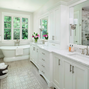 Bathroom - large transitional master multicolored tile and wood-look tile double-sink, porcelain floor and gray floor bathroom idea in Detroit with a built-in vanity, shaker cabinets, white cabinets, white walls, an undermount sink, a hinged shower door, gray countertops, a two-piece toilet and quartz countertops