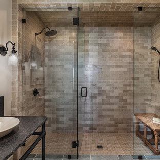 Double shower - mid-sized mediterranean 3/4 beige tile and subway tile ceramic floor and multicolored floor double shower idea in Other with open cabinets, black cabinets, beige walls, a vessel sink, granite countertops, a one-piece toilet and a hinged shower door