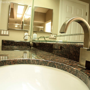 Example of a large classic beige tile and stone tile porcelain floor tub/shower combo design in Orlando with an undermount sink, raised-panel cabinets, light wood cabinets and granite countertops