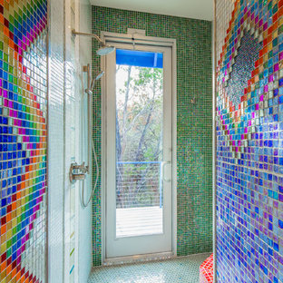 Inspiration for a mid-sized eclectic multicolored tile and glass tile ceramic tile doorless shower remodel in Austin with flat-panel cabinets, white cabinets, a one-piece toilet and multicolored walls