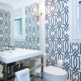 This is an example of a transitional bathroom in Toronto with a console sink.