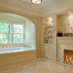 Elegant beige tile bathroom photo in Toronto with beige cabinets and an undermount tub