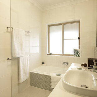 Inspiration for a small contemporary family bathroom in Brisbane with flat-panel cabinets, green cabinets, a built-in bath, a built-in shower, a two-piece toilet, white tiles, mosaic tiles, white walls, porcelain flooring, a vessel sink, engineered stone worktops, beige floors, a hinged door and white worktops.