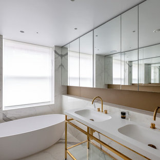 Inspiration for a medium sized contemporary ensuite bathroom in London with a freestanding bath, white tiles, a console sink and white floors.