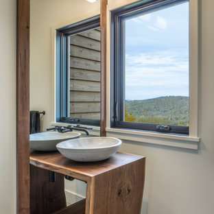 Bathroom - mid-sized contemporary 3/4 porcelain tile gray floor and single-sink bathroom idea in Other with white walls, a vessel sink, medium tone wood cabinets, wood countertops, brown countertops and a built-in vanity