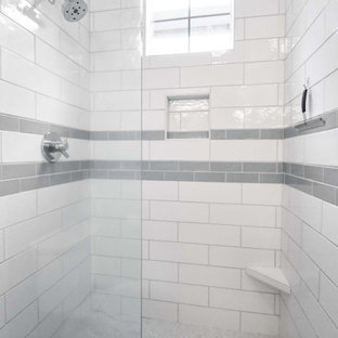 This is an example of a small modern 3/4 bathroom in Portland with flat-panel cabinets, light wood cabinets, an alcove shower, a two-piece toilet, white tile, subway tile, beige walls, cork floors, an undermount sink, engineered quartz benchtops, red floor, a hinged shower door, white benchtops, a niche, a double vanity and a built-in vanity.