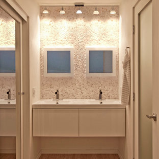 Inspiration for a contemporary pebble tile bathroom remodel in San Diego