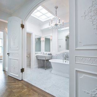 Design ideas for a traditional bathroom in Boston with a freestanding tub, white tile and white walls.