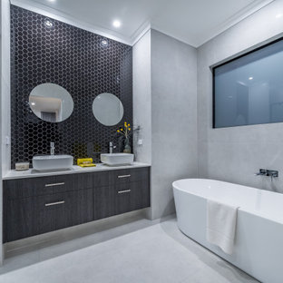 Inspiration for a contemporary bathroom in Perth with flat-panel cabinets, grey cabinets, a freestanding tub, black tile, mosaic tile, a vessel sink, grey floor, white benchtops, a double vanity and a floating vanity.