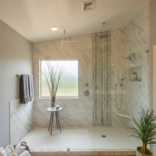 Example of a mid-sized trendy master white tile and porcelain tile terra-cotta tile doorless shower design in Phoenix with gray walls