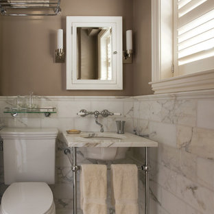 Design ideas for a traditional bathroom in Boston with a console sink and marble.