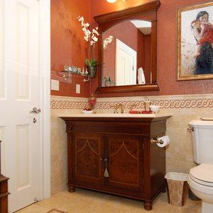 Foto di una stanza da bagno tradizionale con consolle stile comò e pareti arancioni
