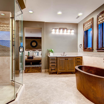 Inspiration for a large timeless master limestone floor bathroom remodel in Denver with granite countertops, raised-panel cabinets and medium tone wood cabinets