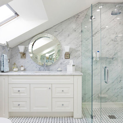 Alcove shower - mid-sized traditional 3/4 white tile and stone slab marble floor alcove shower idea in Sydney with an undermount sink, white cabinets, marble countertops, a two-piece toilet, white walls and raised-panel cabinets