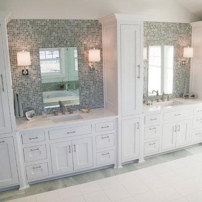 Bathroom - traditional mosaic tile bathroom idea in Dallas with shaker cabinets