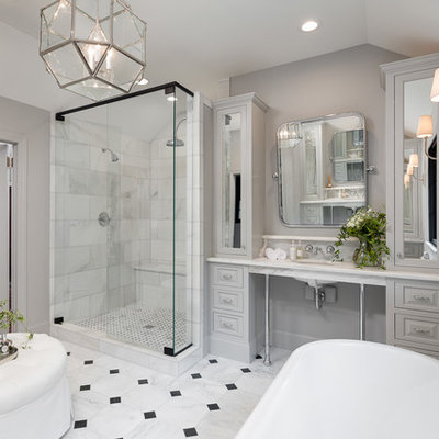 Example of a large classic master black and white tile and stone tile marble floor bathroom design in Other with gray cabinets, a one-piece toilet, gray walls, an undermount sink, marble countertops and raised-panel cabinets