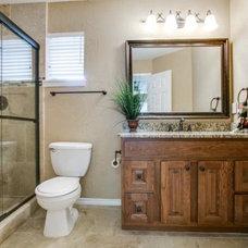 Traditional Bathroom by Premier Real Estate Enterprises