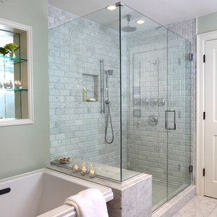 Design ideas for a traditional bathroom in Boston with stone tiles.