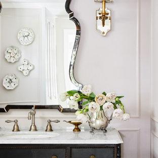 На фото: ванная комната в классическом стиле с тумбой под одну раковину и панелями на части стены с