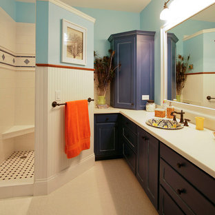 Bathroom - mid-sized traditional 3/4 multicolored tile and porcelain tile porcelain tile and white floor bathroom idea in Other with shaker cabinets, blue cabinets, a two-piece toilet, blue walls, a drop-in sink and solid surface countertops