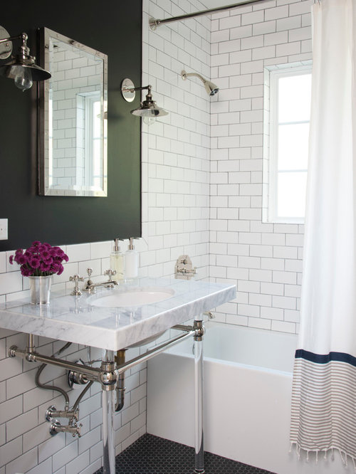 example of a classic master subway tile and black and white tile mosaic tile floor bathroom