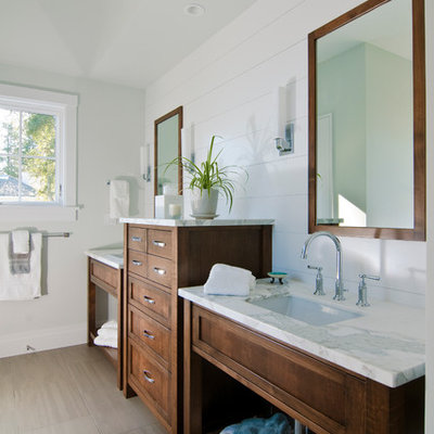 Inspiration for a timeless gray tile bathroom remodel in San Francisco with an undermount sink, dark wood cabinets and shaker cabinets