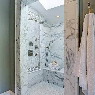 Example of a mid-sized classic master white tile marble floor bathroom design in San Francisco with green walls, raised-panel cabinets, white cabinets, a one-piece toilet and a drop-in sink