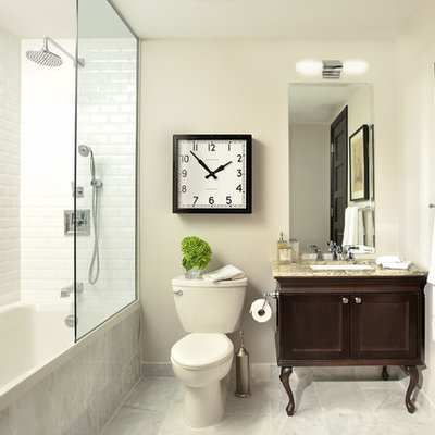 Example of a classic white tile and subway tile bathroom design in Toronto with an undermount sink, furniture-like cabinets, dark wood cabinets, a two-piece toilet and white walls