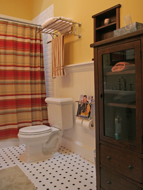 example of a classic white tile and subway tile bathroom design in atlanta with dark wood
