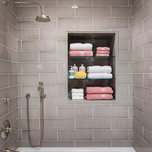 Inspiration for a small timeless gray tile bathroom remodel in Los Angeles with gray walls and a niche
