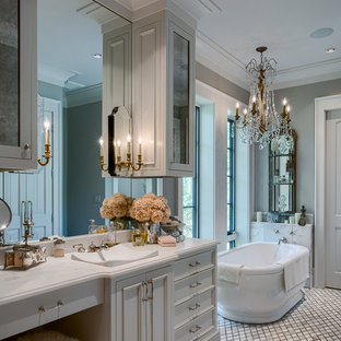 Freestanding bathtub - french country 3/4 mosaic tile floor and white floor freestanding bathtub idea in Other with furniture-like cabinets, white cabinets, gray walls and a vessel sink