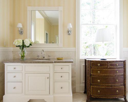 traditional beige tile bathroom idea in atlanta with an undermount sink raisedpanel cabinets