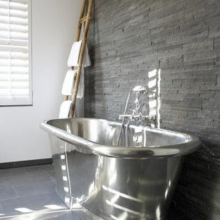 Photo of a medium sized contemporary bathroom in Sydney with a freestanding bath and slate tiles.