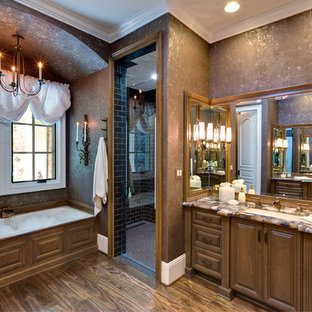 Bathroom - large traditional master subway tile dark wood floor and brown floor bathroom idea in Orange County with brown walls, raised-panel cabinets, dark wood cabinets, an undermount sink and a hinged shower door