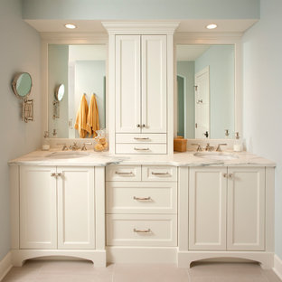 This is an example of a traditional bathroom in Minneapolis with an undermount sink, recessed-panel cabinets and white cabinets.