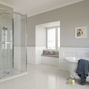 Inspiration for a large traditional master bathroom in Other with a claw-foot tub, a corner shower, grey walls, porcelain floors, white tile and ceramic tile.
