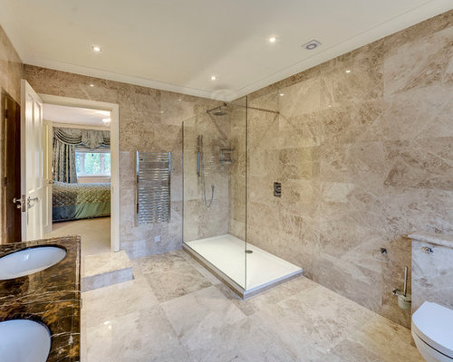 this is an example of a large classic ensuite bathroom in london with beige tiles