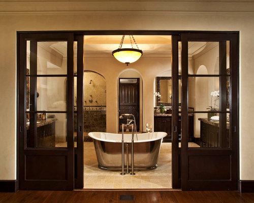 large traditional master ceramic floor bathroom idea in orange county with dark wood cabinets beige
