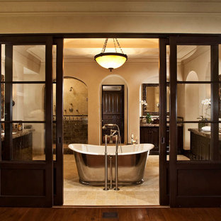 Bathroom - large traditional master ceramic tile bathroom idea in Orange County with dark wood cabinets, beige walls, an undermount sink and granite countertops