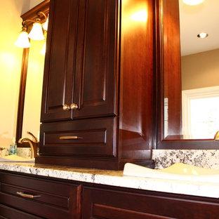 Imagen de cuarto de baño principal, tradicional, grande, con lavabo sobreencimera, armarios con paneles con relieve, puertas de armario de madera en tonos medios, encimera de granito, bañera encastrada, ducha esquinera, sanitario de dos piezas, baldosas y/o azulejos marrones, baldosas y/o azulejos de porcelana, paredes marrones y suelo de baldosas de porcelana