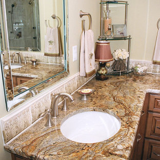 Example of a large classic master white tile and porcelain tile porcelain floor bathroom design in Other with an undermount sink, raised-panel cabinets, medium tone wood cabinets, granite countertops, a two-piece toilet and yellow walls