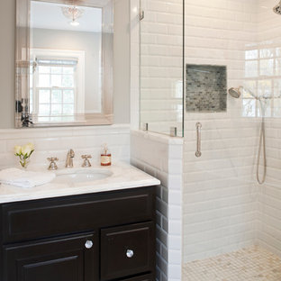 Example of a classic corner shower design in New York with an undermount sink