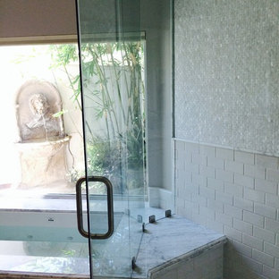 Inspiration for a timeless master white tile and subway tile travertine floor corner shower remodel in Other with marble countertops, an undermount tub and gray walls