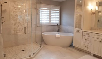 Traditional Style White Bathroom with Glass Shower Enclosure and Vanity Mirror