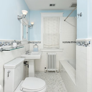 Design ideas for a medium sized traditional bathroom in DC Metro with metro tiles, an alcove bath, a shower/bath combination, a two-piece toilet, white tiles, blue walls, mosaic tile flooring and a pedestal sink.